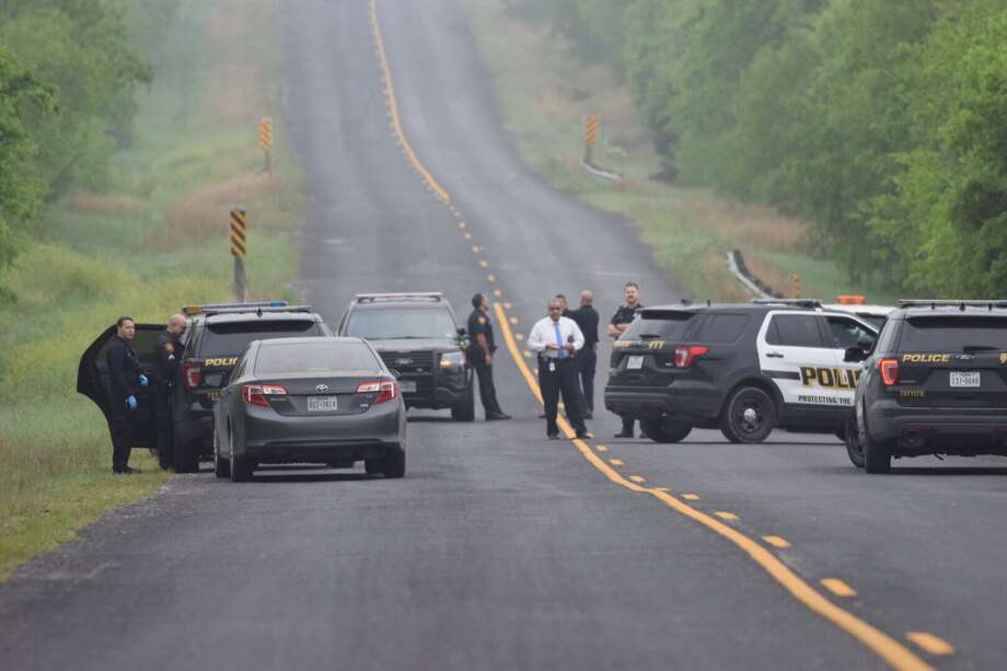 A woman was found shot to death early Thursday along a vacant stretch of road on the East Side. Photo: Caleb Downs / San Antonio Express-News