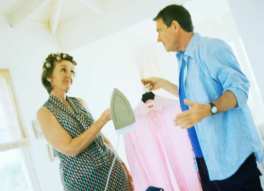 A couple argues over the division of labor in their household. Photo: Patrick Sheandell O'Carroll/Getty Images/PhotoAlto