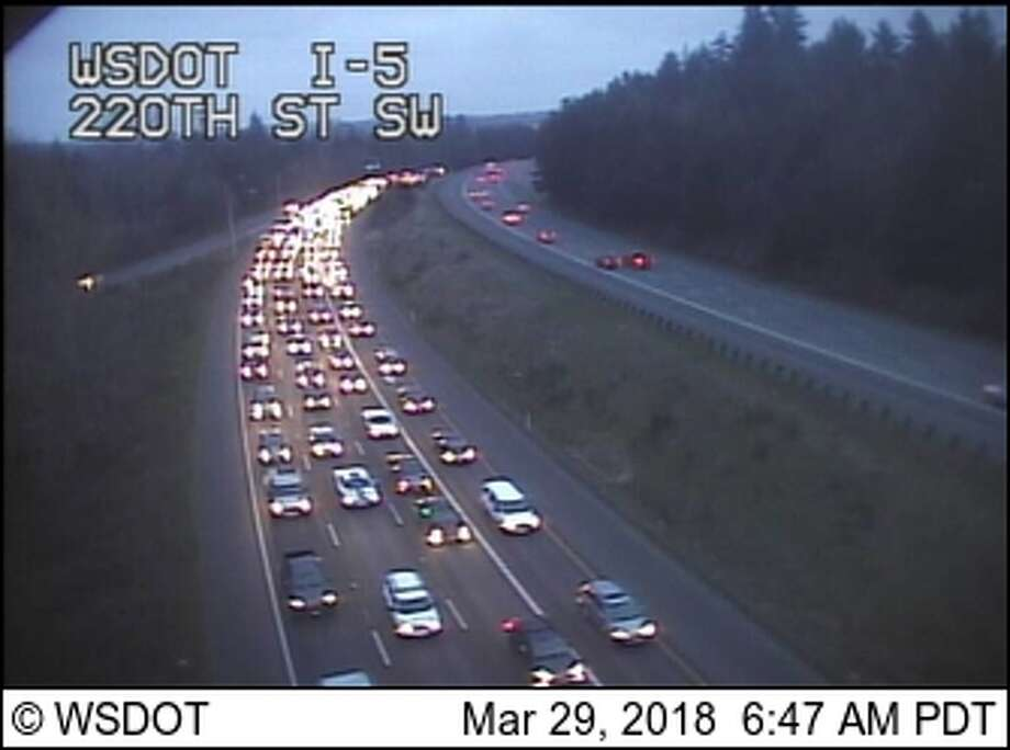 A collision involving an SPD motorcycle officer backed up traffic on southbound I-5 Thursday morning. Photo: WSDOT