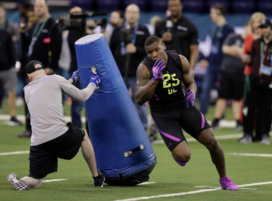 Kansas defensive lineman Dorance Armstrong runs a drill during the NFL football scouting combine, Sunday, March 4, 2018, in Indianapolis. (AP Photo/Darron Cummings) Photo: Darron Cummings, Associated Press / Copyright 2018 The Associated Press. All rights reserved.