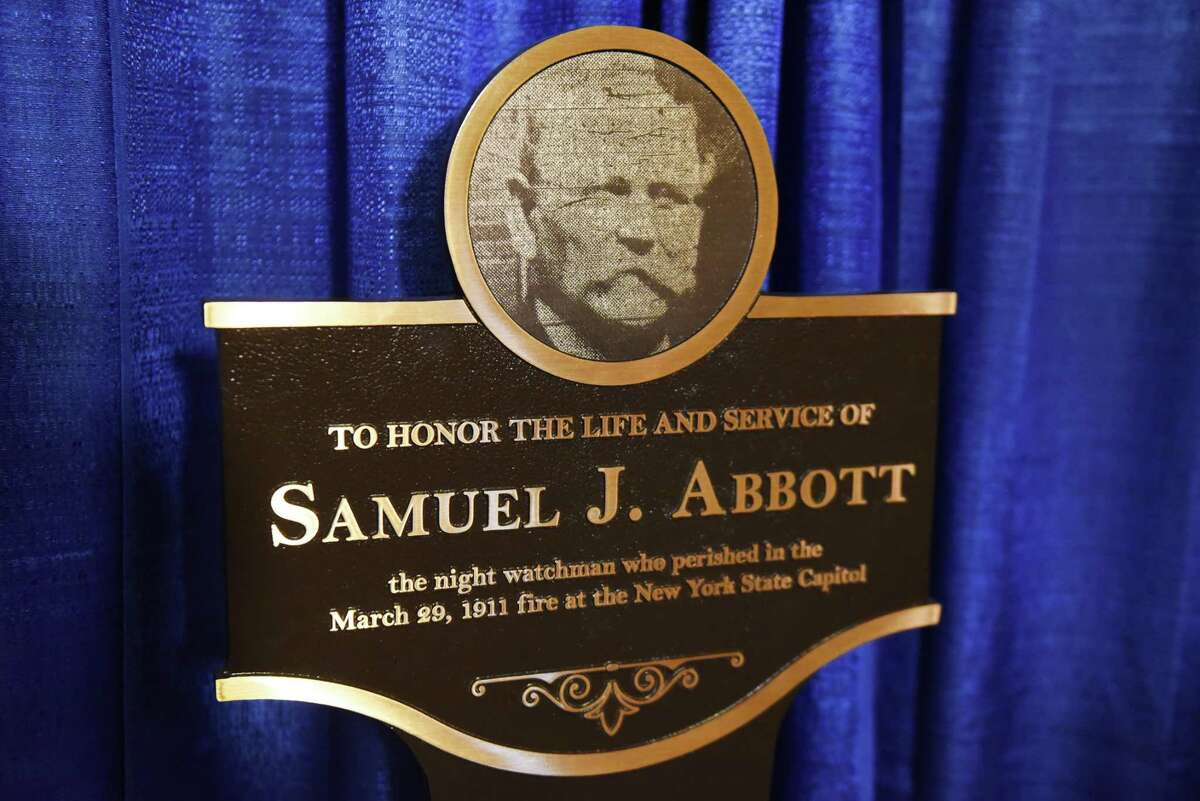 A historic plaque honoring Samuel J. Abbott, a civil War veteran who lost his life while serving as a night watchman during the Capitol fire 1911, was unveiled at the Capitol on Thursday, March 29, 2018, in Albany, N.Y. The plaque was placed outside the Legislative Library where Abbott worked. (Will Waldron/Times Union)