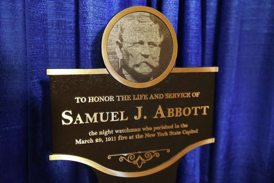 A historic plaque honoring Samuel J. Abbott, a civil War veteran who lost his life while serving as a night watchman during the Capitol fire 1911, was unveiled at the Capitol on Thursday, March 29, 2018, in Albany, N.Y. The plaque was placed outside the Legislative Library where Abbott worked. (Will Waldron/Times Union) Photo: Will Waldron, Albany Times Union / 20043351A