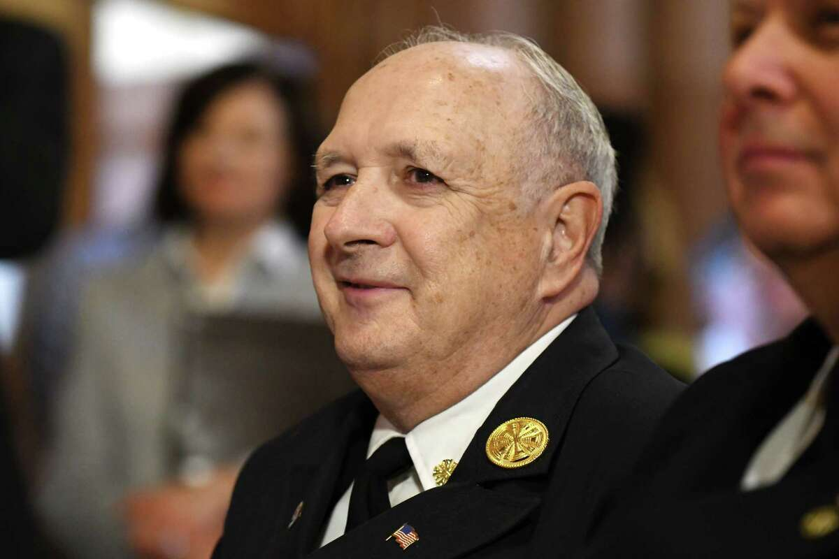 Albany Fire Chief Warren W. Abriel, Jr. attends the unveiling of a historic plaque honoring Samuel J. Abbott, a civil War veteran who lost his life while serving as a night watchman during the Capitol fire 1911, outside the Legislative Library on Thursday, March 29, 2018, at the Capitol in Albany, N.Y. (Will Waldron/Times Union)