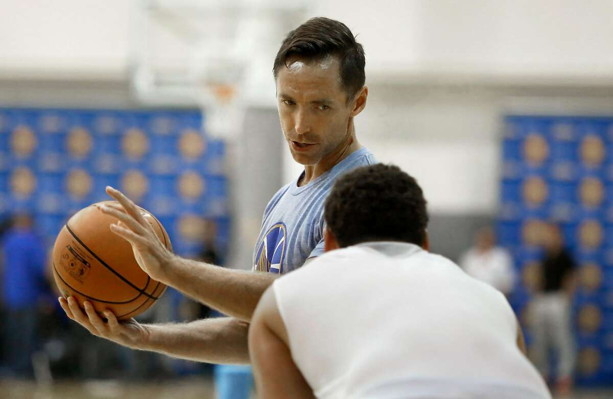 Player development consultant Steve Nash works with Warriors guard Klay Thompson at the Warriors gym in Oakland, Calif., on Friday, October 2, 2015.