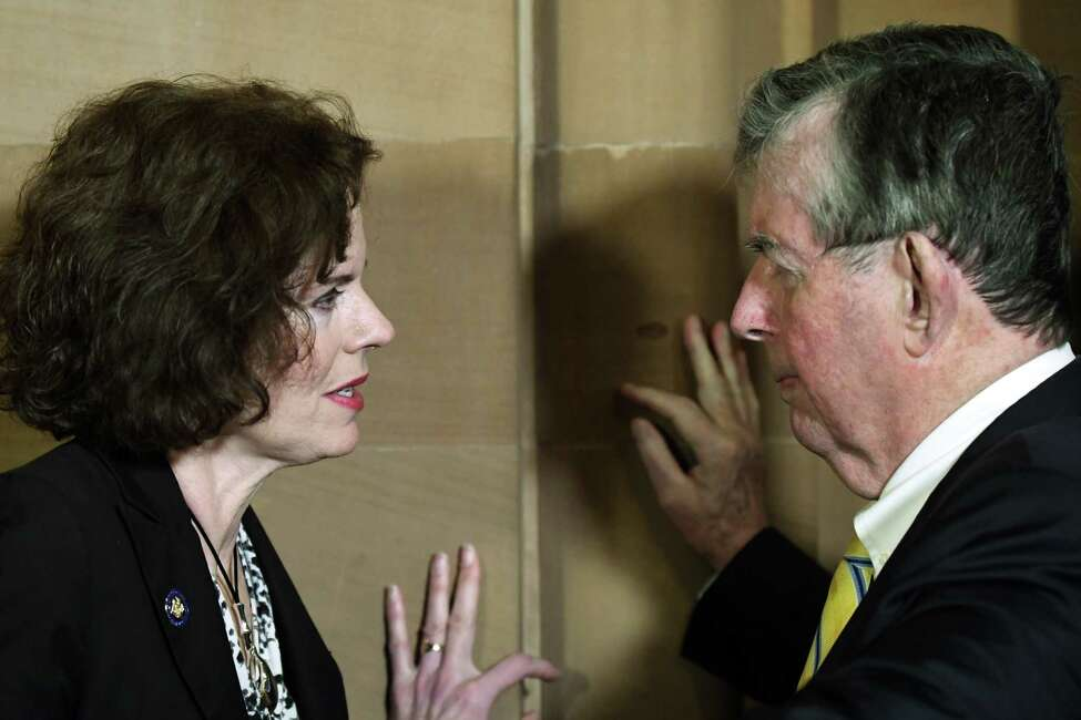 Assemblymember Patricia Fahy, left, and Sen Neil Breslin, right, talk in a hallway following the unveiling of a historic plaque on Thursday, March 29, 2018, at the Capitol in Albany, N.Y. (Will Waldron/Times Union)