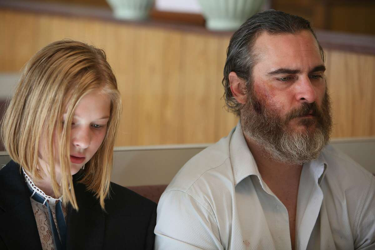 """Dante Pereira-Olson, left, and Joaquin Phoenix in """"You Were Never Really Here"""""""