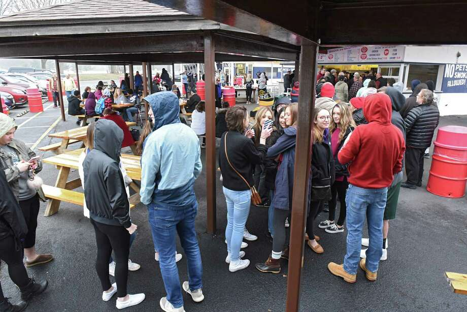 A little rain doesn't stop Jumpin' Jack's from drawing a large crowd on their season opening day on Thursday, March 29, 2018 in Scotia N.Y. (Lori Van Buren/Times Union) Photo: Lori Van Buren, Albany Times Union / 20043114A