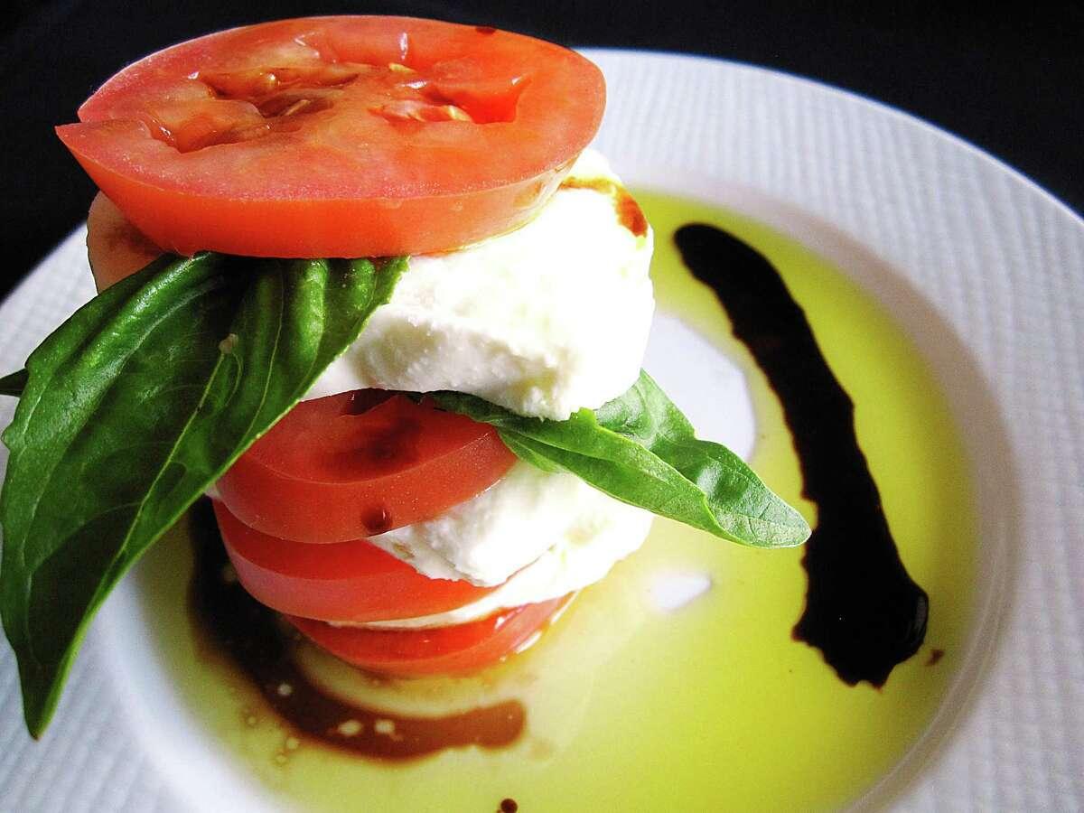 Caprese salad with mozzarella, basil, tomatoes, olive oil and balsamic vinegar from Pesto Ristorante.