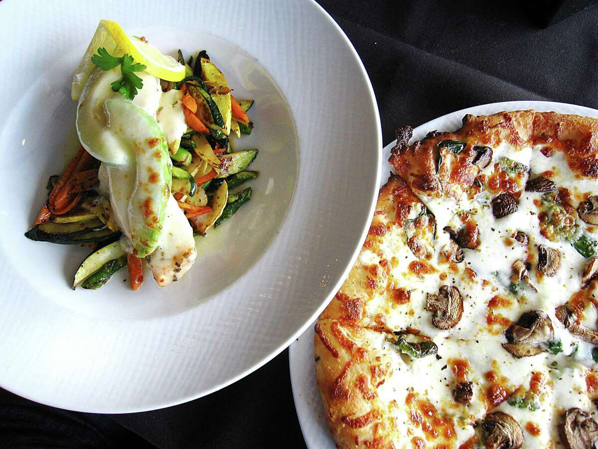 Pesto Ristorante's menu includes avocado salmon with mozzarella and roasted vegetables and a pizza bianco with alfredo sauce, mushrooms, spinach and mozzarella. The Italian restaurant has opened its third location downtown in the former home of Bella on Houston.