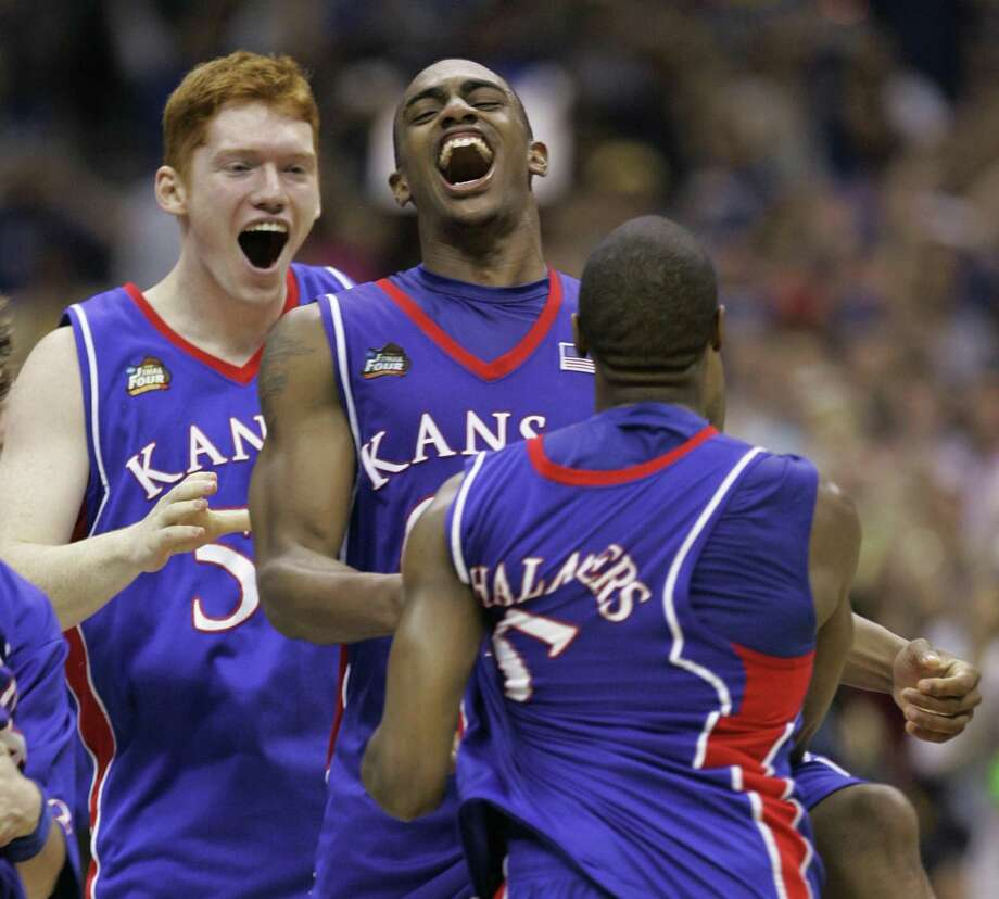 Kansas' Matt Kleinmann (54), Darrell Arthur, center, and Mario Chalmers, right, celebrate their 75-68 victory over Memphis in overtime in the championship game at the NCAA college basketball Final Four Monday, April 7, 2008, in San Antonio. (AP Photo/Charlie Neibergall) Photo: Charlie Neibergall, STF / AP / AP