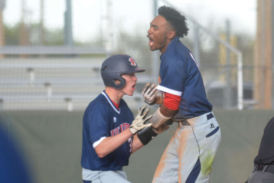 Plainview's Brodrick Jackson, right, celebrates with teammate Riley Bennett after Jackson scored the winning run in the bottom of the eighth inning Wednesday to give the Bulldogs an 8-7 victory over Dumas at Bulldog Field. Photo: Skip Leon/Plainview Herald
