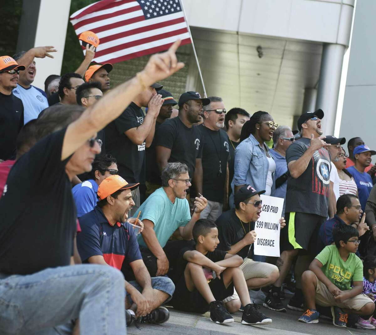 Members of the International Brotherhood of Electrical Workers' Local 3 chapter picket outside the Charter Communications headquarters at 400 Atlantic St., in downtown Stamford, Conn., on Aug. 9, 2017. Local 3 technicians have been on strike since March 28, 2017, over a disagreement about new contract terms.