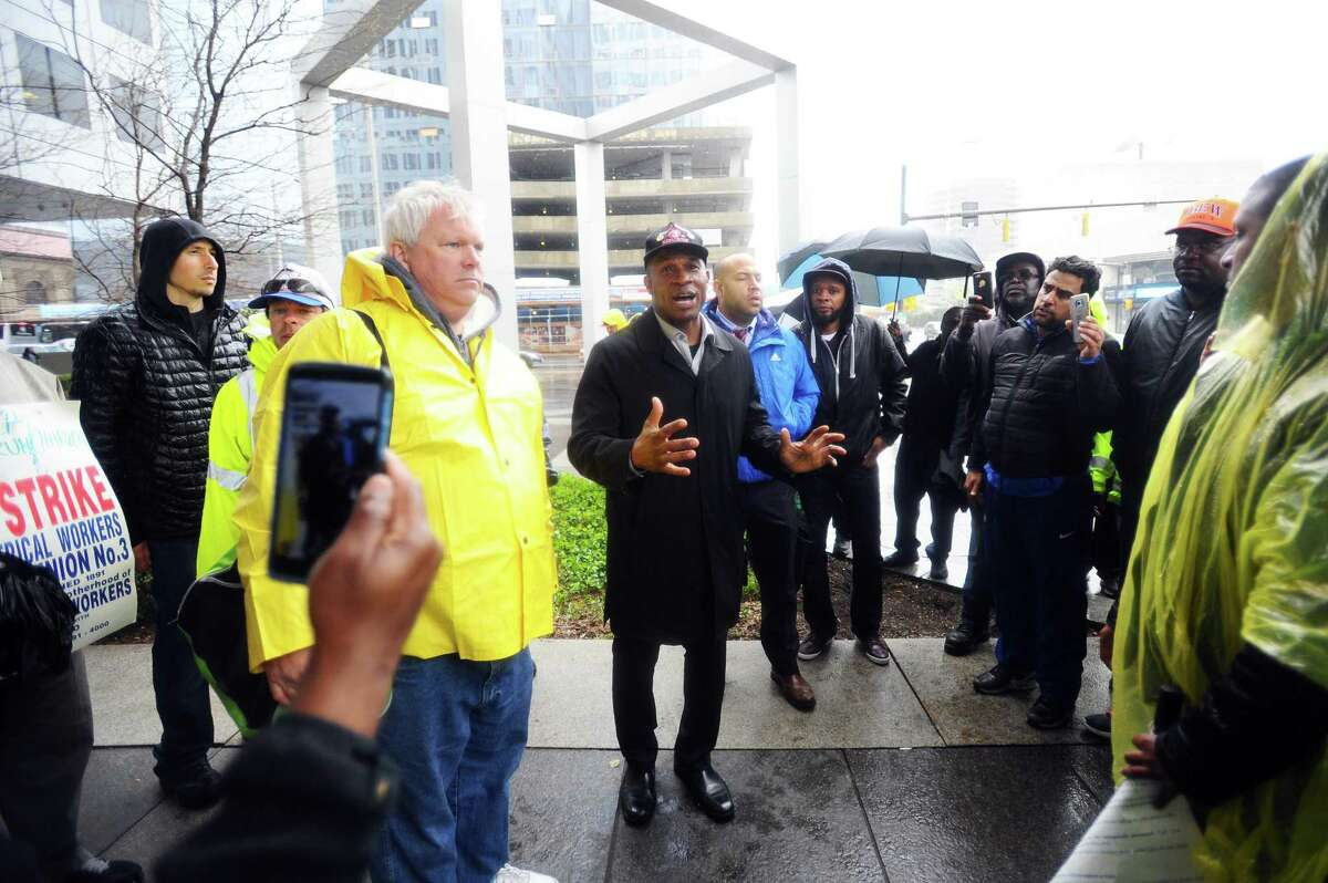 Derek Jordan, the business representative for the International Brotherhood of Electrical Workers' Local 3 chapter, speaks to union members during a picket outside of Charter Communications' headquarters at 400 Atlantic St., in downtown Stamford, Conn. on Tuesday, April 25, 2017.