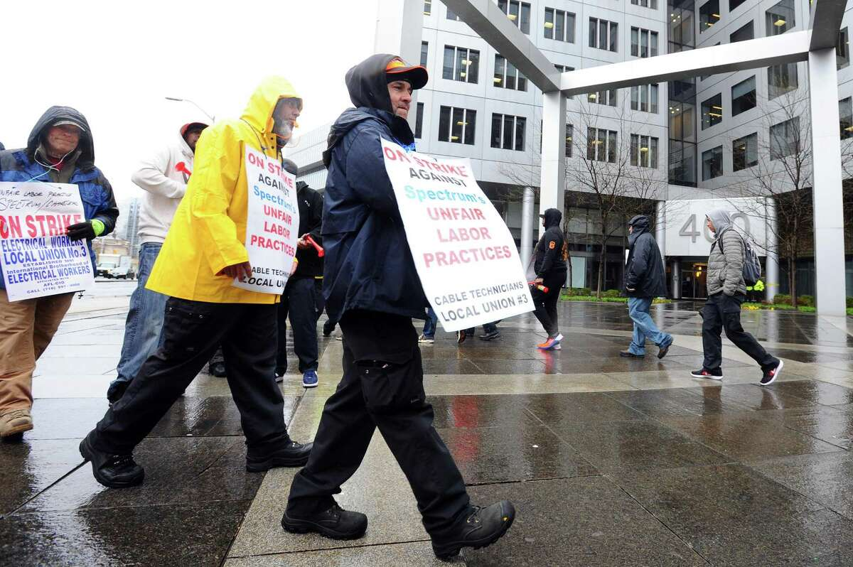 Members of the International Brotherhood of Electrical Workers' Local 3 chapter demonstrate outside the Charter Communications headquarters at 400 Atlantic St., in Stamford, Conn. on April 25, 2017.