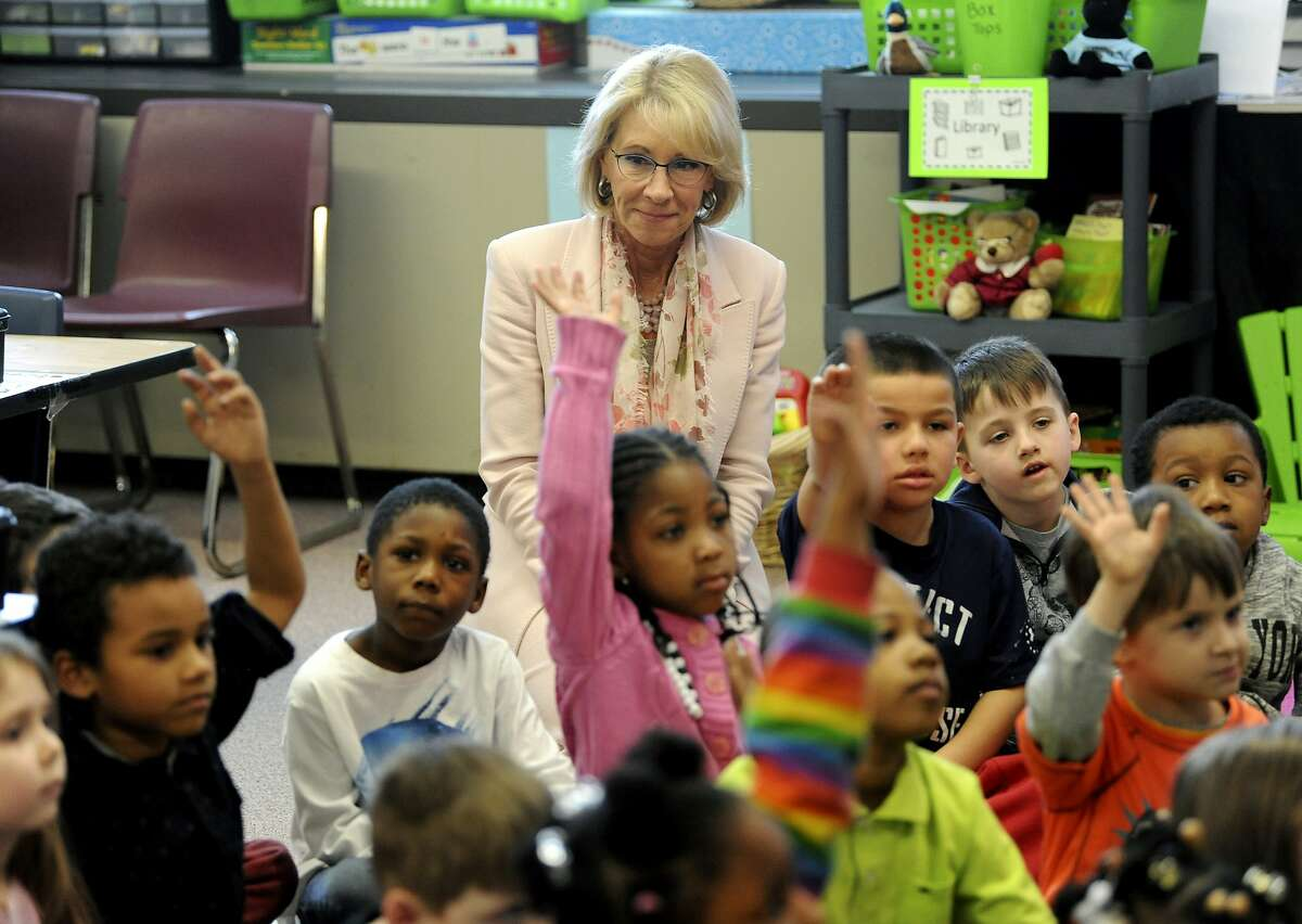 U.S. Secretary of Education Betsy Devos sits in with a class at Greater Johnstown Elementary School in Johnstown, Pa., Monday, March 26, 2018. (John Rucosky/The Tribune-Democrat via AP)