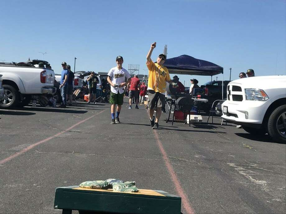 Oakland A's fans hold tailgate parties in the Coliseum parking lot on Opening Day. Photo: Peter Fimrite / The Chronicle