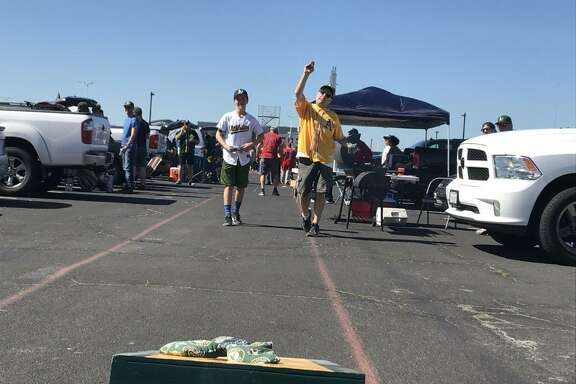 Oakland A's fans hold tailgate parties in the Coliseum parking lot on Opening Day.