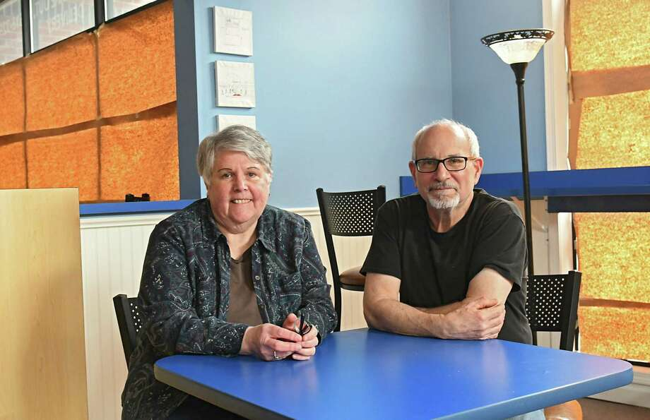 Owners of The Hungry Hollow Janet Rothacker and John Baideme sit in their closed restaurant in Sheridan Hollow on Wednesday, March 28, 2018 in Albany, N.Y. (Lori Van Buren/Times Union) Photo: Lori Van Buren, Albany Times Union / 20043336A