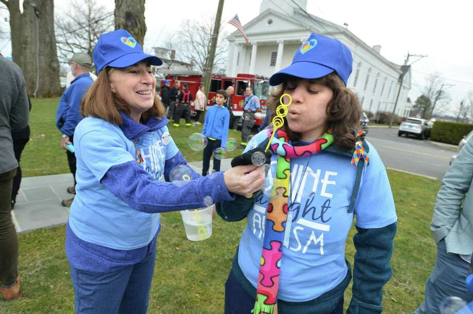 Dawn DiNoto and her daughter Anisa blow some bubbles together during a ceremony on the Historic Town Green to launch Autism Awareness Month in Norwalk Conn on Monday April 3, 2017. The gazebo was lit in blue and the community played on the green to music, and got an up close look at a fire truck. Photo: Alex Von Kleydorff / Hearst Connecticut Media / Norwalk Hour