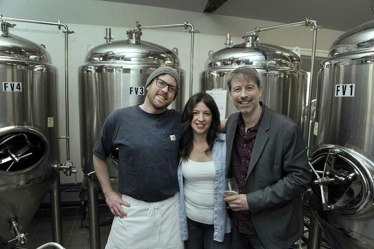From left, Paul Mannion, Lisa Tassone and Chris Sanzeni, are co-owners of Broken Symmetry Gastro Brewery in Bethel. Photo Thursday, March 29, 2018.