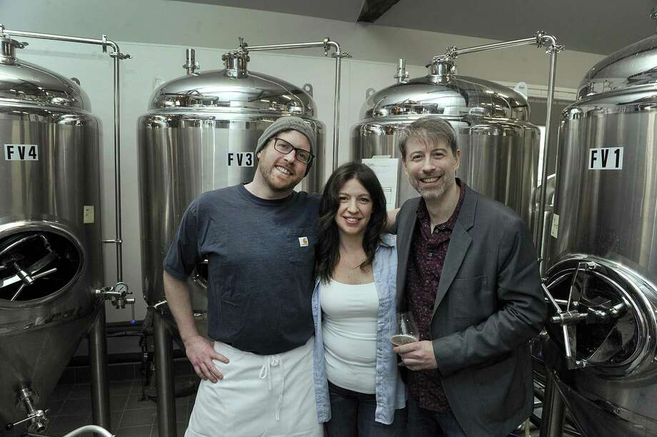 From left, Paul Mannion, Lisa Tassone and Chris Sanzeni, are co-owners of Broken Symmetry Gastro Brewery in Bethel. Photo Thursday, March 29, 2018. Photo: Carol Kaliff / Hearst Connecticut Media / The News-Times