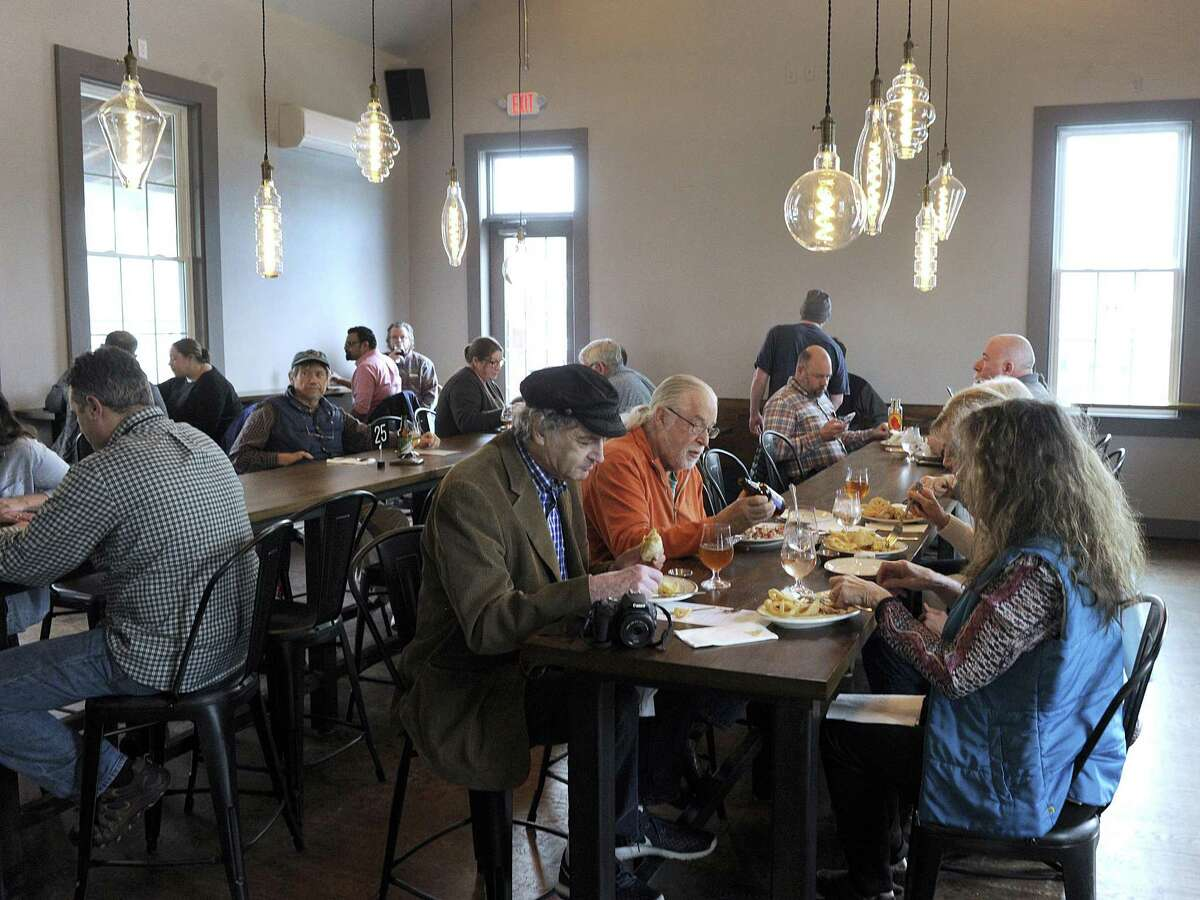A lunch-time crowd at the Broken Symmetry Gastro Brewery in Bethel, which recently opened in a building that was once the Bethel Train Station. Photo Thursday, march 29, 2018.
