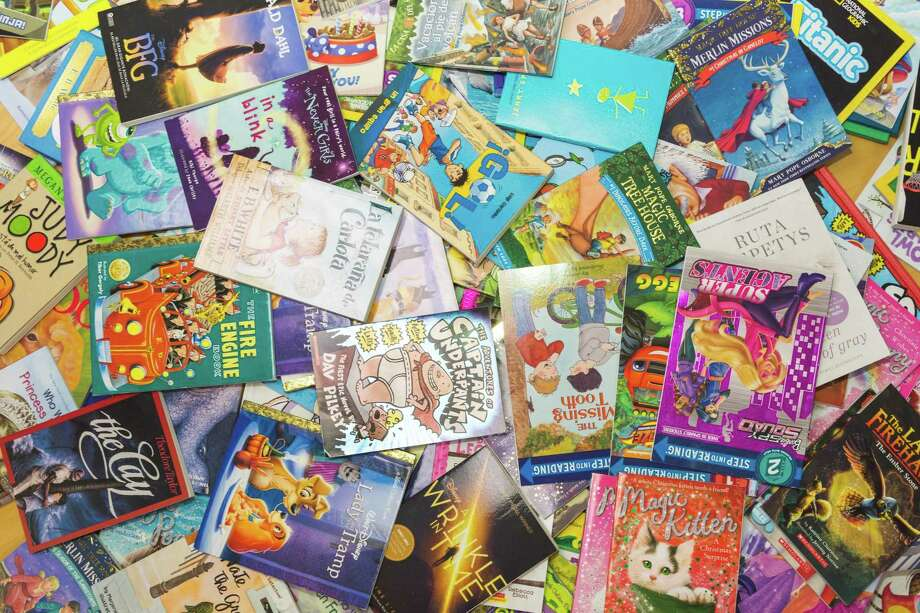 The Stratford-based UNESCO Center for Global Friendship, Inc. will hold a book drive in April to collect 3,000 books for its free library programs in Haiti, Nicaragua and Jamaica. File photo. Photo: Courtesy Of The Periwinkle Foundation / Courtesy Of The Periwinkle Foundation / Larry G Photo