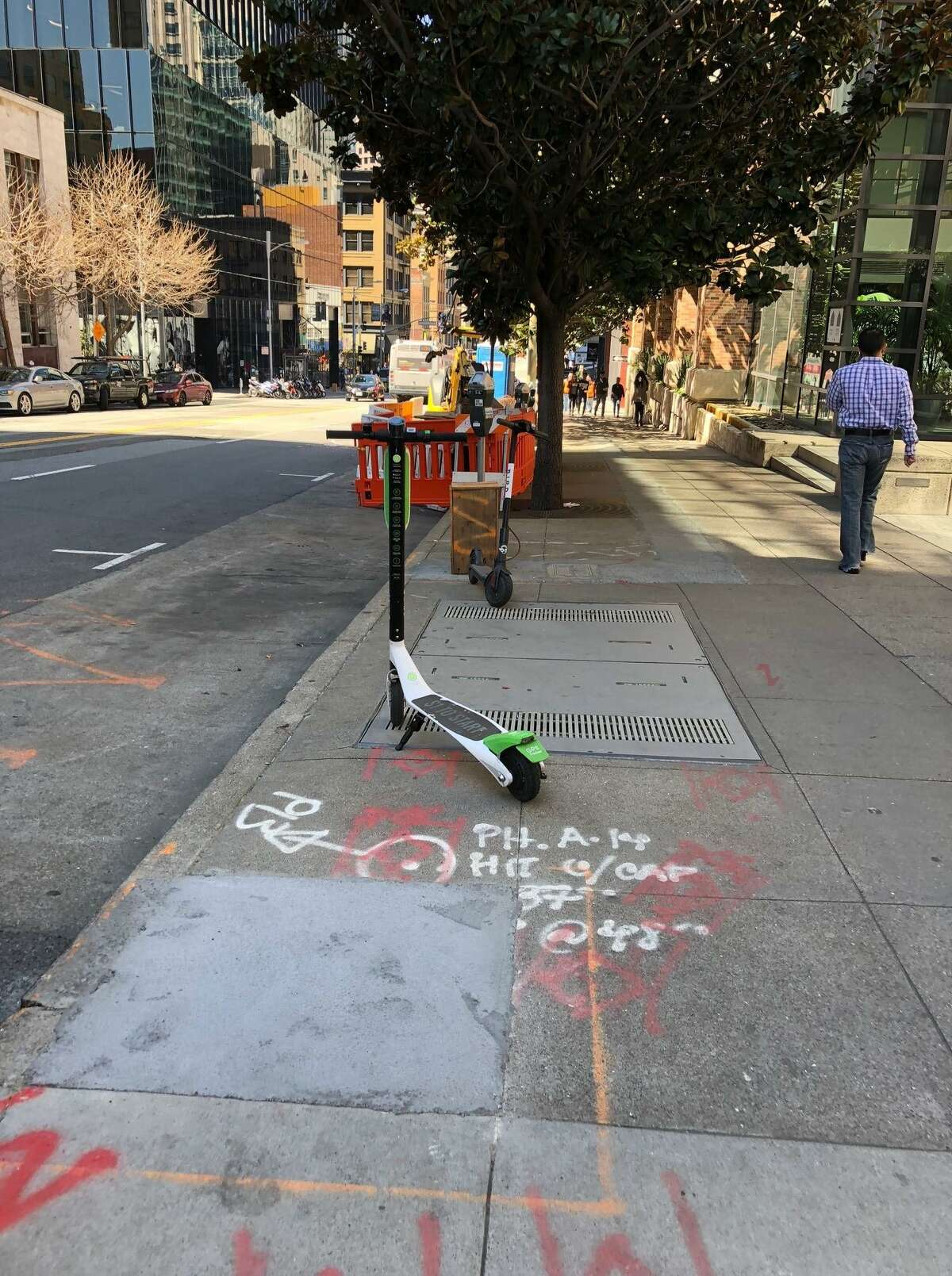 A LimeBike e-scooter on a South of Market sidewalk.