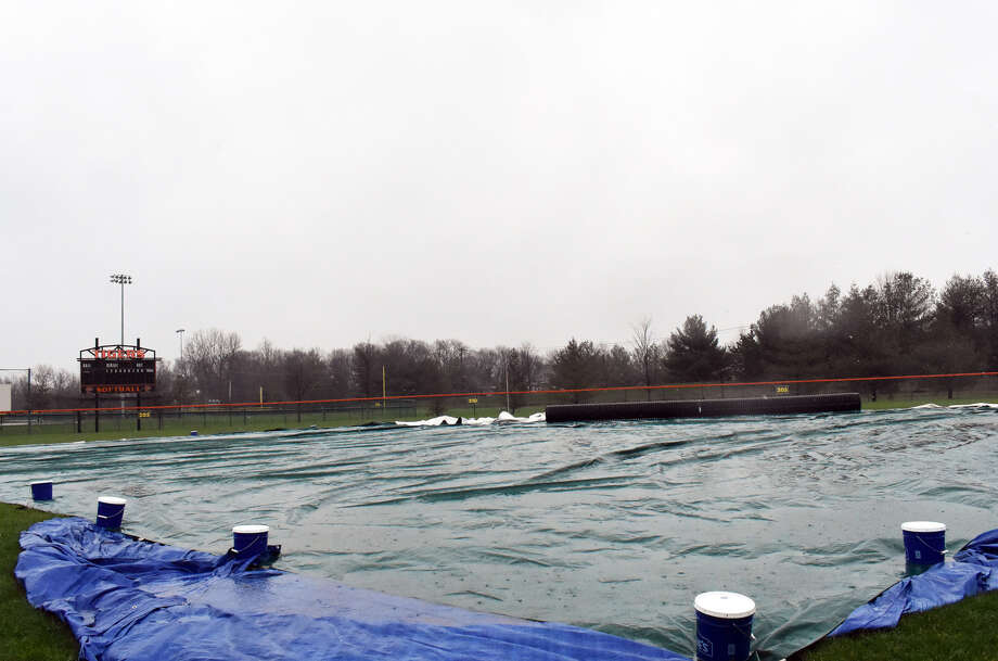 Rain falls on the EHS softball field on Thursday afternoon.