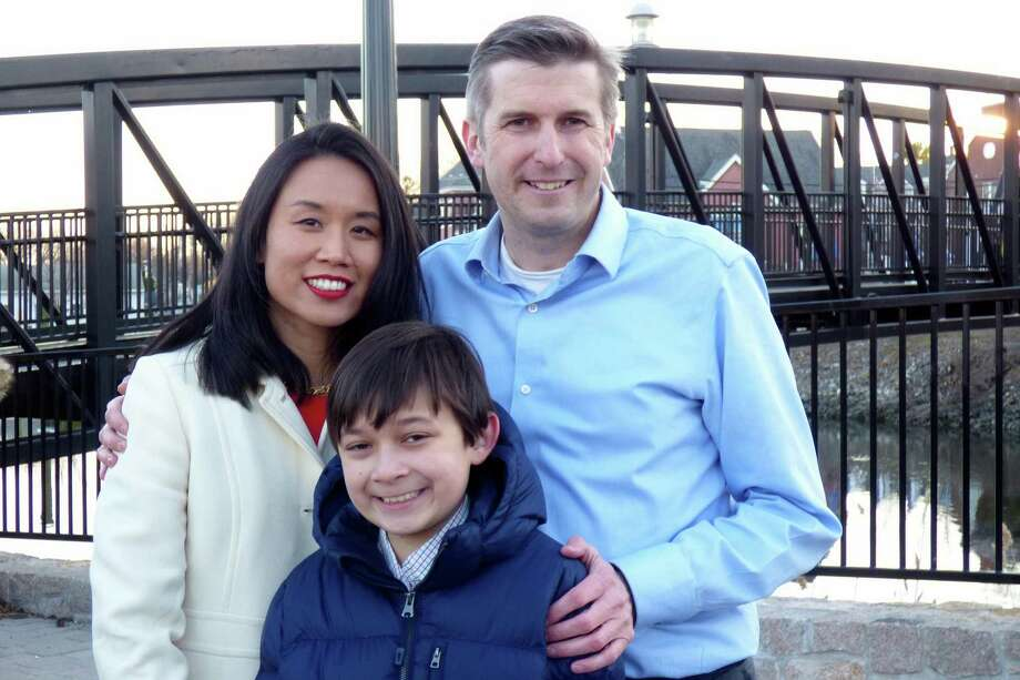 Milford resident James Maroney, a Democrat who is looking to fill State Sen. Gayle Slossberg's seat in the 14th district, is pictured at the announcement of his candidacy with his wife, Dr. Jennifer Ju, and their son, Jay. Photo: Contributed Photo