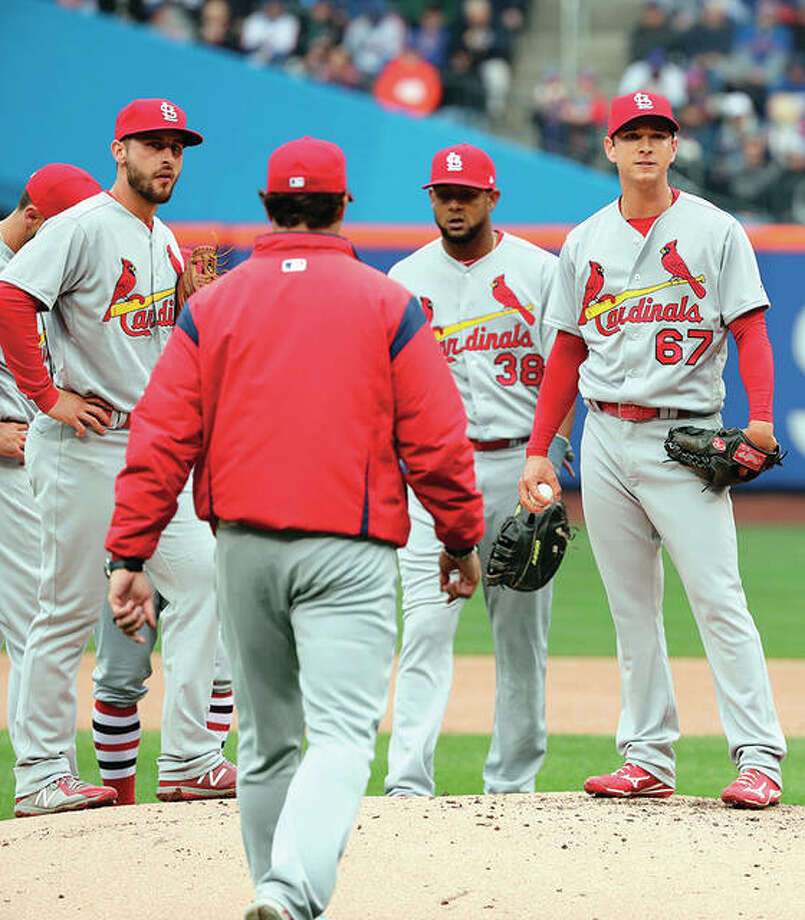 Cardinals pitcher Matt Bowman reacts with teammates as manager Mike Matheny walks to the mound to take Bowman out of the game in the fifth inning of Thursday's season opener in New York. Photo: AP