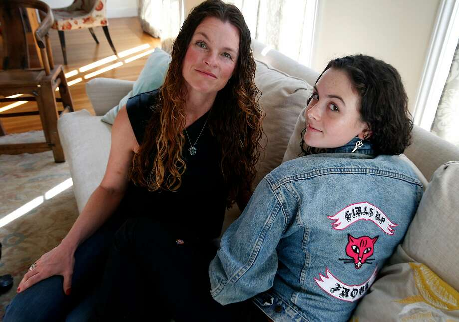 Girls Up Front co-founder Beth Miles with her daughter Somerset Miles-Dwyer, 15, wearing a denim jacket, at their home. Miles used to design the Ses Petites Mains clothing line. Photo: Paul Chinn / The Chronicle