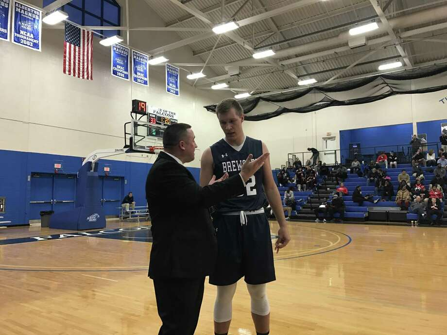 Lukas Kisunas, seen here with Brewster Academy coach Jason Smith at the National Prep Showcase, was released from his national letter of intent by UConn on Thursday. Photo: David Borges / Hearst Connecticut Media