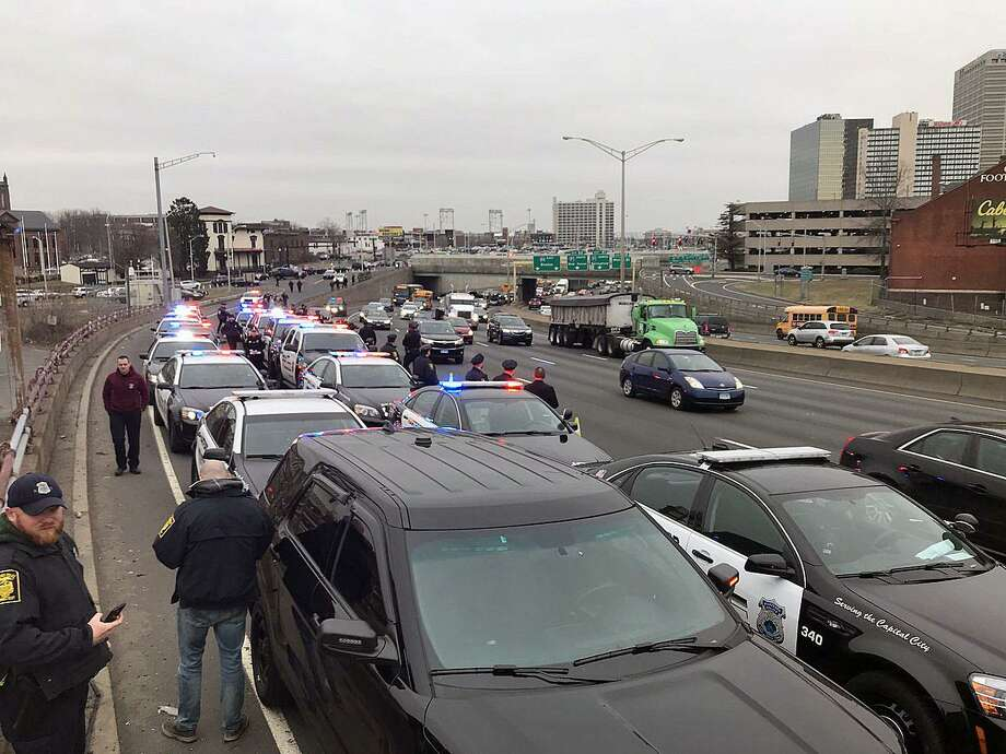 A fleet of Hartford police officers waiting on the highway on March 29, 2018. The officers are waiting for the procession escorting fallen Trooper First Class Kevin M. Miller to the Medical Examiner's office in Farmington. Miller died Thursday from injuries sustained during a crash in Tolland, Conn., on the highway while he was on duty. Photo: Contributed Photo / Deputy Chief Brian J. Foley Of Hartford Police Department / Connecticut Post Contributed
