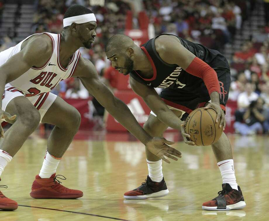Houston Rockets guard Chris Paul (3) sizes up Chicago Bulls forward Noah Vonleh (30) in the second half at the Toyota Center on Tuesday, March 27, 2018, in Houston. Rockets won the game 118-86. ( Elizabeth Conley / Houston Chronicle ) Photo: Elizabeth Conley, Chronicle / Houston Chronicle / © 2018 Houston Chronicle