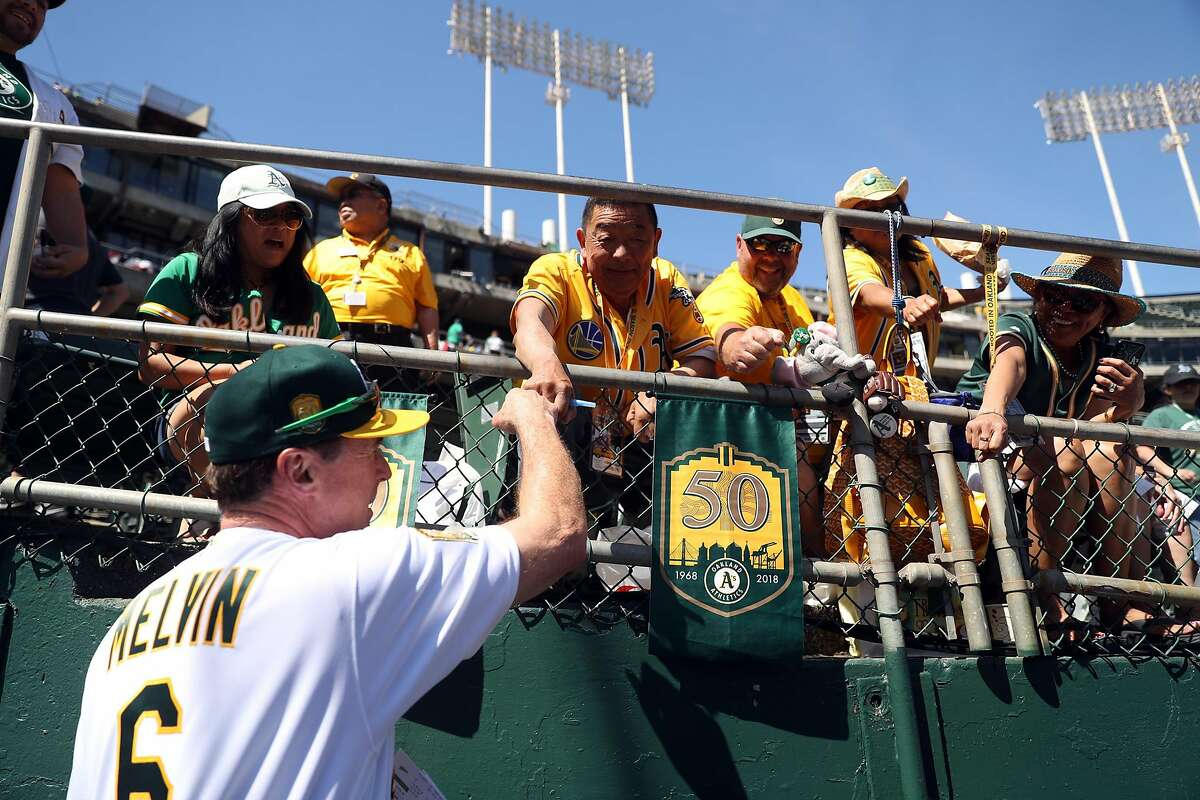 Oakland Athletics' manager Bob Melvin greets fans before A's play Los Angeles Angels in season opening game at Oakland Coliseum in Oakland, Calif., on Thursday, March 29, 2018.