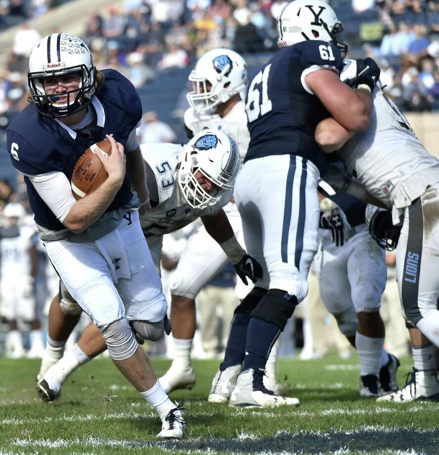 Yale quarterback Kurt Rawlings scores the Bulldogs' second touchdown against Columbia last fall. Photo: Peter Hvizdak / Hearst Connecticut Media / New Haven Register