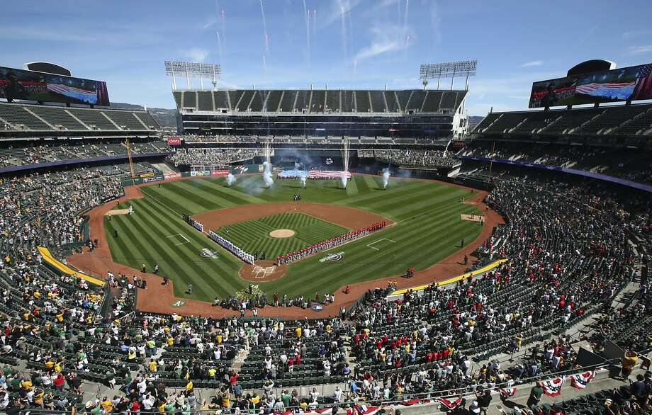 The Los Angeles Angels and the Oakland Athletics stand for the national anthem at Oakland Coliseum on Opening Day. Photo: Ben Margot / Associated Press