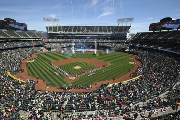 The Los Angeles Angels and the Oakland Athletics stand for the national anthem at Oakland Coliseum prior to an opening day baseball game on Thursday, March 29, 2018 in Oakland, Calif. (AP Photo/Ben Margot)