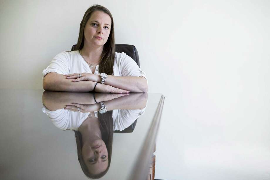 Julie Thomas sits in one of the conference rooms at the Buenker Law Firm on Thursday, March 22, 2018, in Houston. Thomas, a former employee of The Woodland Fire Department, filed a lawsuit in federal court against the Township and its President and General Manager Don Norrell for alleged sexual harassment and wrongful termination of employment. She worked as a customer service representative for the department and has said in the lawsuit that during her employment she was subjected to frequent sexual harassment with pervasive comments about her appearance, clothing and body. ( Brett Coomer / Houston Chronicle ) Photo: Brett Coomer, Staff / Houston Chronicle / © 2018 Houston Chronicle