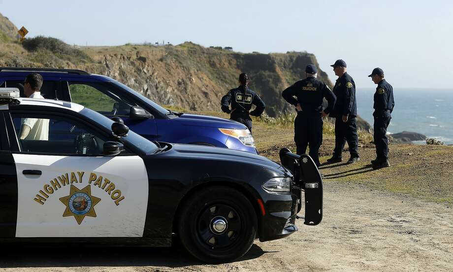 California Highway Patrol officers and deputy sheriffs from Mendocino and Alameda counties gather after a search for three missing children Wednesday, March 28, 2018, at the site where the bodies of Jennifer and Sarah Hart and three of their adopted children were recovered two days earlier. Photo: Alvin Jornada / Associated Press