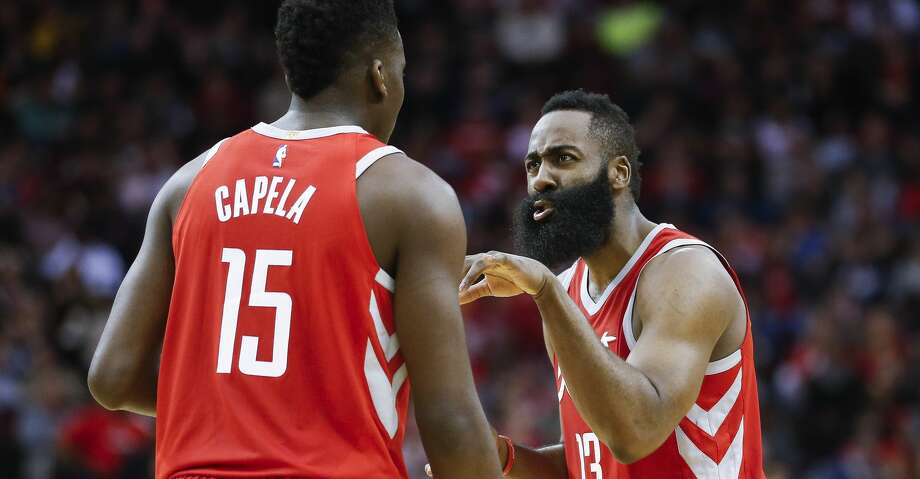 Houston Rockets guard James Harden (13) talks with center Clint Capela (15) during a free throw as the Houston Rockets take on the Dallas Mavericks at the Toyota Center Sunday, Feb. 11, 2018 in Houston. (Michael Ciaglo / Houston Chronicle) Photo: Michael Ciaglo/Houston Chronicle