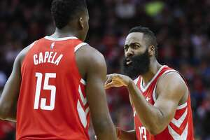 Houston Rockets guard James Harden (13) talks with center Clint Capela (15) during a free throw as the Houston Rockets take on the Dallas Mavericks at the Toyota Center Sunday, Feb. 11, 2018 in Houston. (Michael Ciaglo / Houston Chronicle)