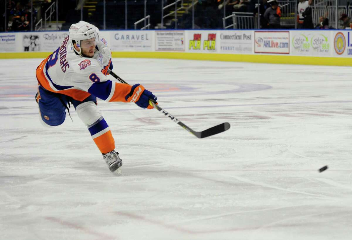 Kyle Burroughs (8) of the Bridgeport Sound Tigers rips a shot during Game 2 of the 2016 Calder Cup Playoffs against the Toronto Marlies at Webster Bank Arena on April 24, 2016 in Bridgeport, Connecticut.