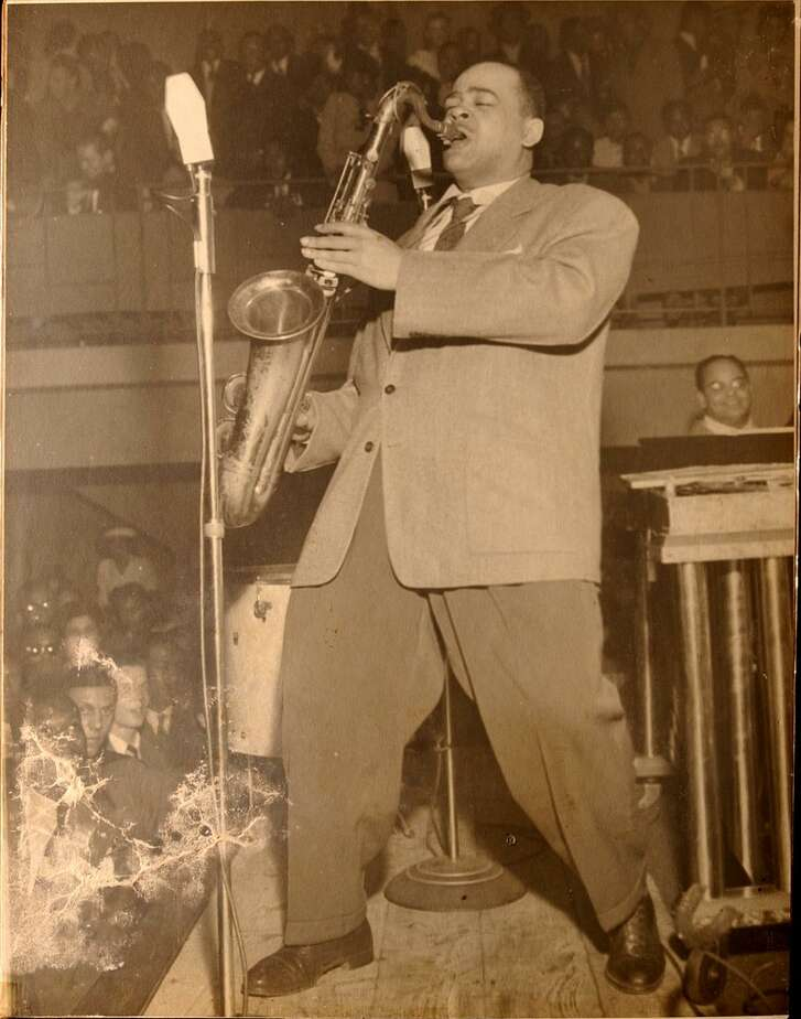 """Historic photo of """"Arnett Cobb performing"""" at an unknown location."""
