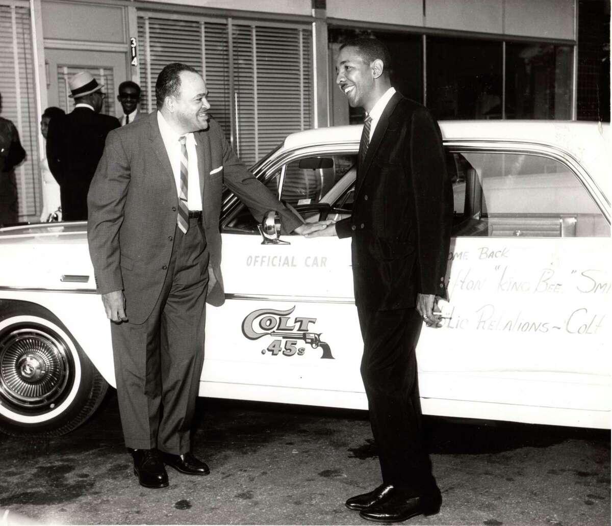Houston jazz great Arnett Cobb, left, pictured in 1963 with the Houston Colt .45s car.