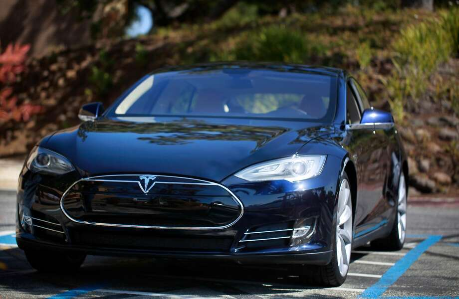 """The """"blue"""" Tesla Model S sedan sits on display in the parking lot at Tesla Headquarters on Friday July 13, 2012 in Palo Alto, Calif. Photo: Mike Kepka / The Chronicle 2012"""