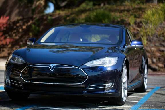 """The """"blue"""" Tesla Model S sedan sits on display in the parking lot at Tesla Headquarters on Friday July 13, 2012 in Palo Alto, Calif."""