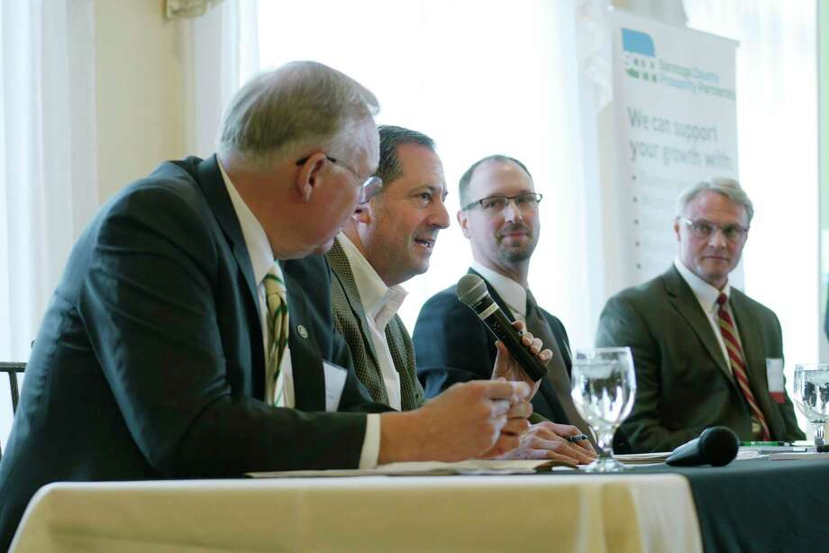Panelists, from left to right, Charles Wait, chairman of the board and CEO of Adirondack Trust Company, David Deutsch, founder and president of David N. Deutsch and Company, Drew Jarosh, Saratoga County tresaurer and Spencer Hellwig, Saratoga County administrator, take part in a discussion during an event put on by the Saratoga County Prosperity Partnership to release data from their Saratoga County Economic Index report on Thursday, March 29, 2018, at The Vista Restaurant at Van Patten Golf Club in Clifton Park, N.Y.  (Paul Buckowski/Times Union) Photo: PAUL BUCKOWSKI / (Paul Buckowski/Times Union)