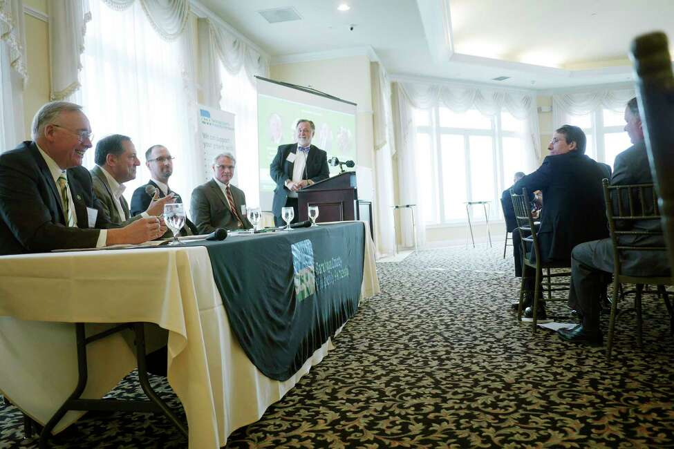 Panelists, from left to right, Charles Wait, chairman of the board and CEO of Adirondack Trust Company, David Deutsch, founder and president of David N. Deutsch and Company, Drew Jarosh, Saratoga County tresaurer, Spencer Hellwig, Saratoga County administrator, and Marty Vanags, president of the Saratoga County Prosperity Partnership take part in a discussion during an event put on by the Saratoga County Prosperity Partnership to release data from their Saratoga County Economic Index report on Thursday, March 29, 2018, at The Vista Restaurant at Van Patten Golf Club in Clifton Park, N.Y. (Paul Buckowski/Times Union)
